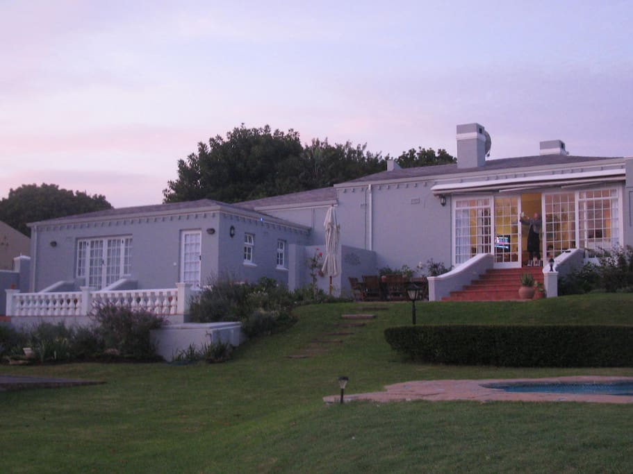 Cottage is viewed on the left of the main house.