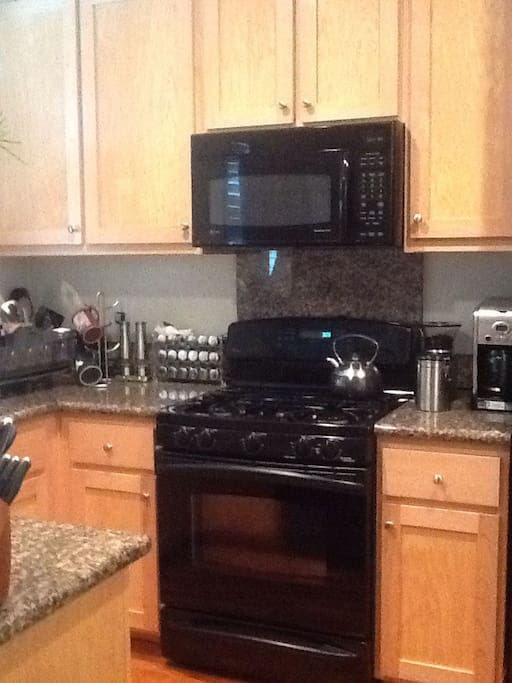 Fully equipped kitchen with granite counter tops.