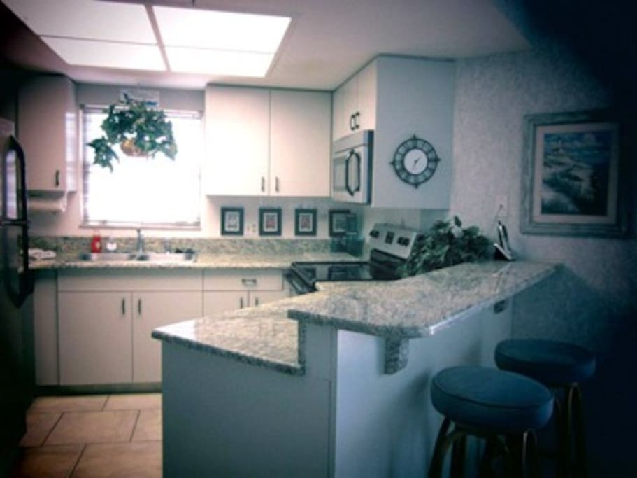 Stainleess steel, granite countertop kitchen