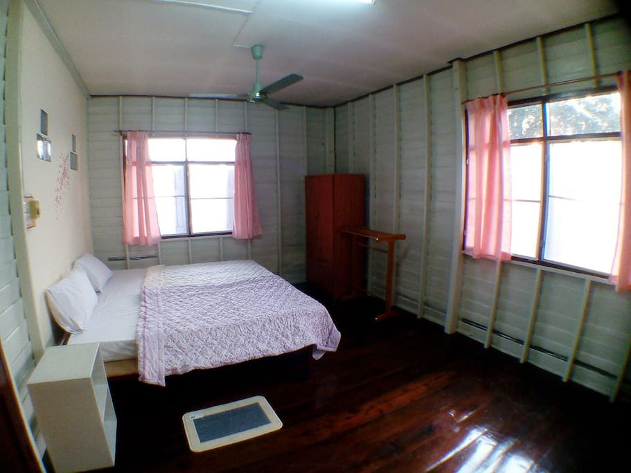 Wooden room with a double bed