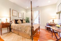Queen size four posted bed with writing desk