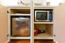 Butlers pantry with mini refrigerator and micro wave