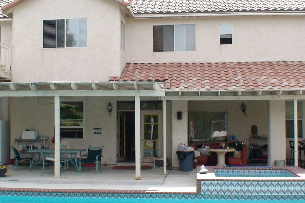PATIO AREA IN FRONT OF THE POOL
