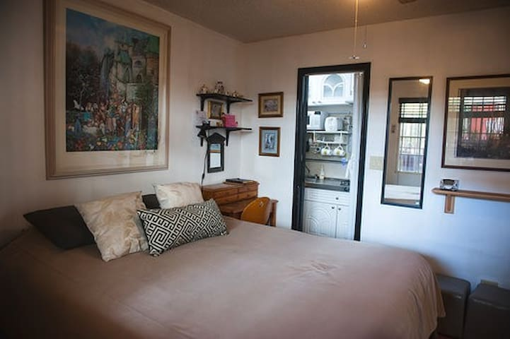 Our small casita fits a queen bed in the room. A small desk sits on the right hand side of the bedroom.