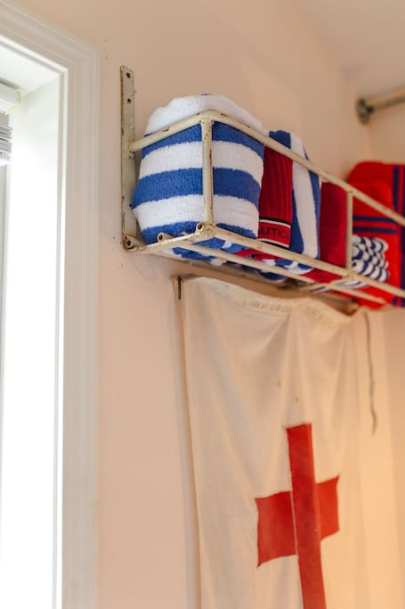 Colorful bath linens await a trip across the hall to well appointed guest bathroom.