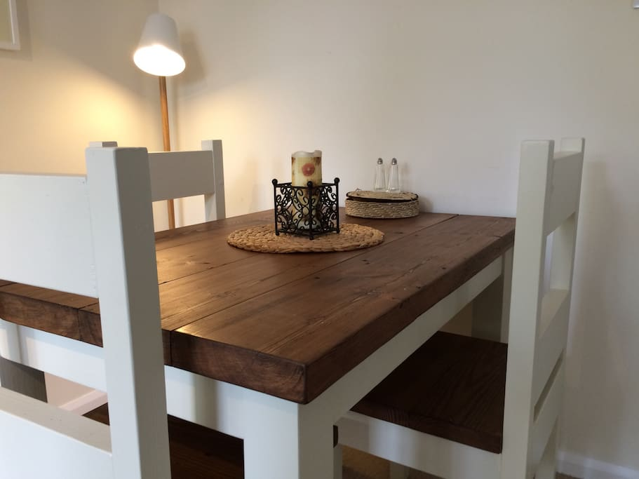 The rustic, chunky wood dining table can accommodate 4.