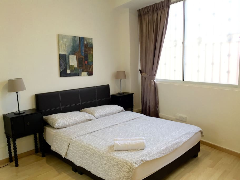 Queen bed with bed sets and towels provided