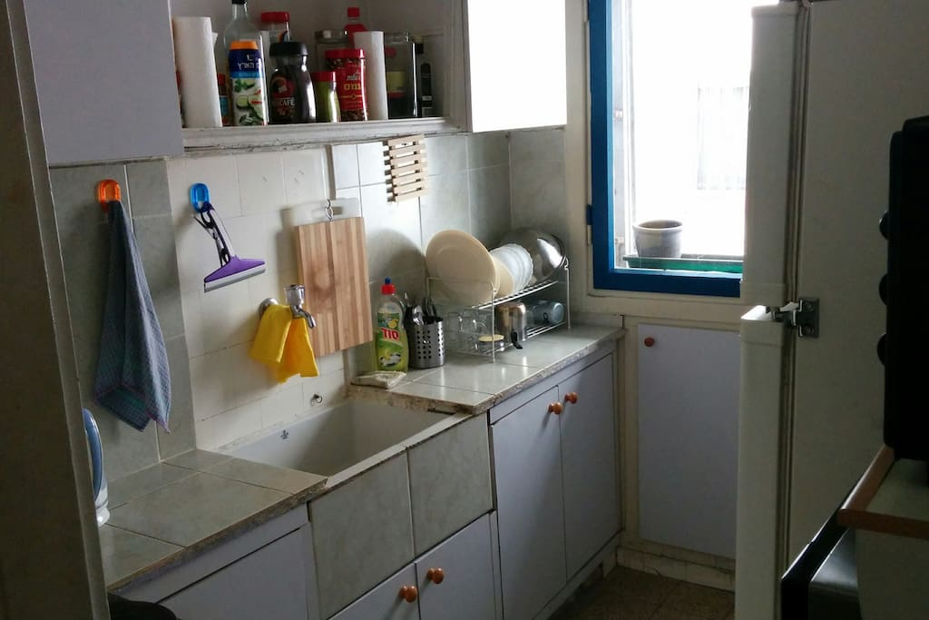 Kitchen with fridge, toaster-oven, microwave, Nespresso machine and electric cooker