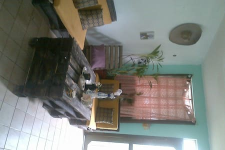 Great location, 5min from the beach road and 3min from the center of tulum. Safe,colorful and allfurnished apartment great for a couple or 1 person, includes washmachine, stove fridge,a/c,fans,bed for 2 bathroom,livingroom, INTERNET,etc