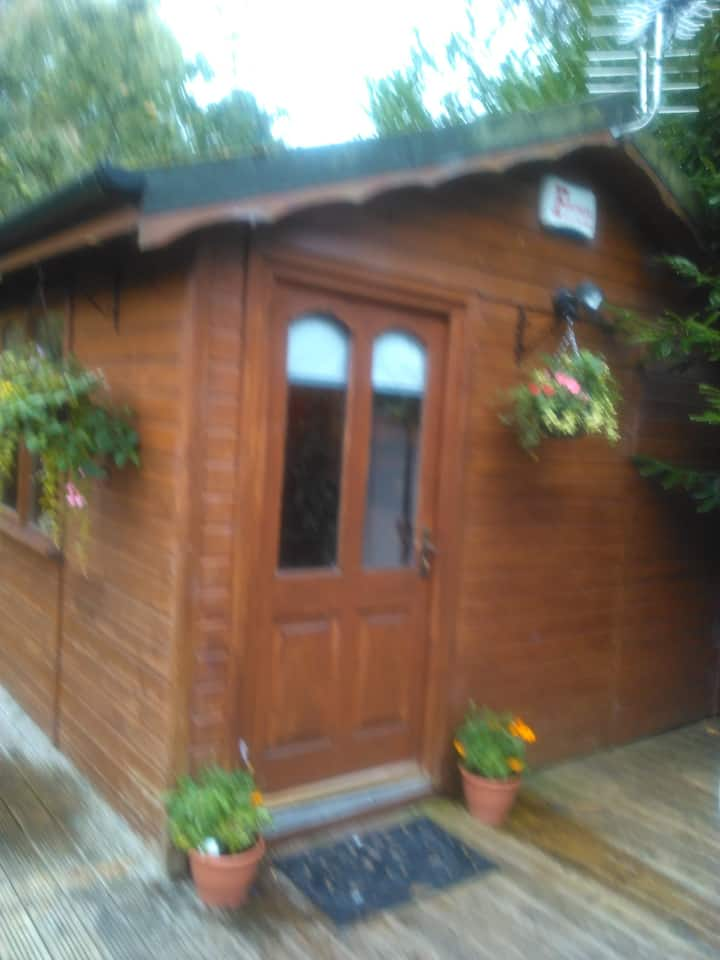 Small clean log cabin in the garden