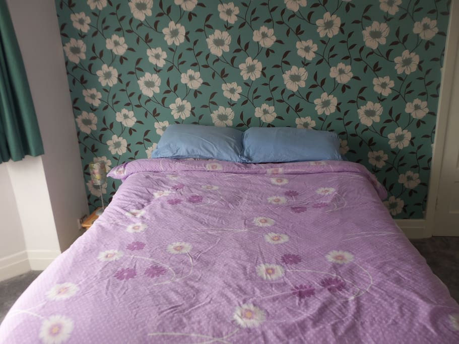 Large bedroom with comfy double bed