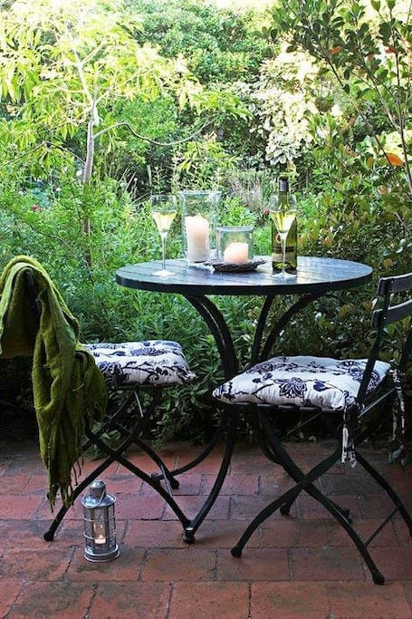 Enjoy evening drinks on the patio outside Streamside Cottage listening to the stream bubbling past.