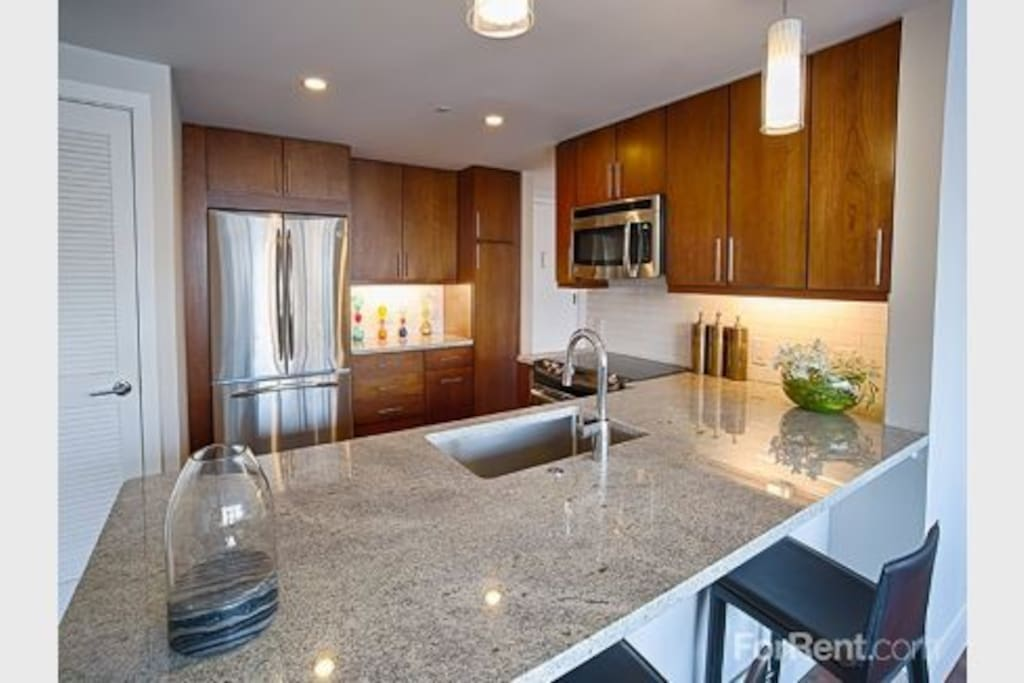 Granite Counter Tops  and large open kitchen