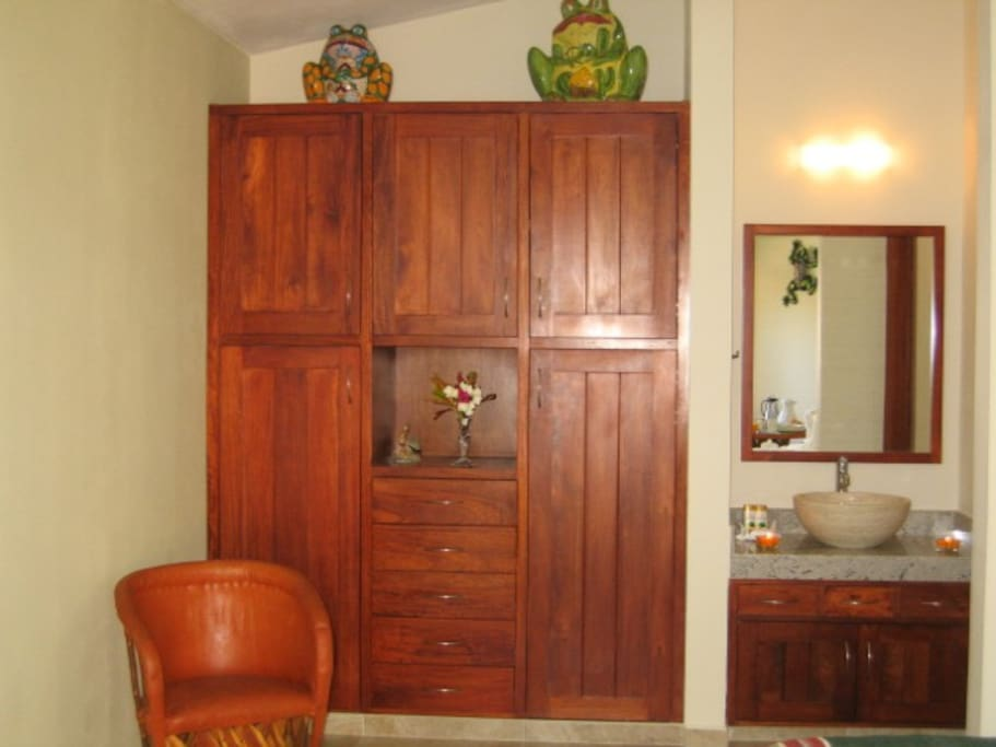 Each unit has custom Mahogany built in cabinet for all your clothing needs.Bathroom is granite with a marble sink. Shower is a glassed enclosure.This is a new property and has every convenience available.