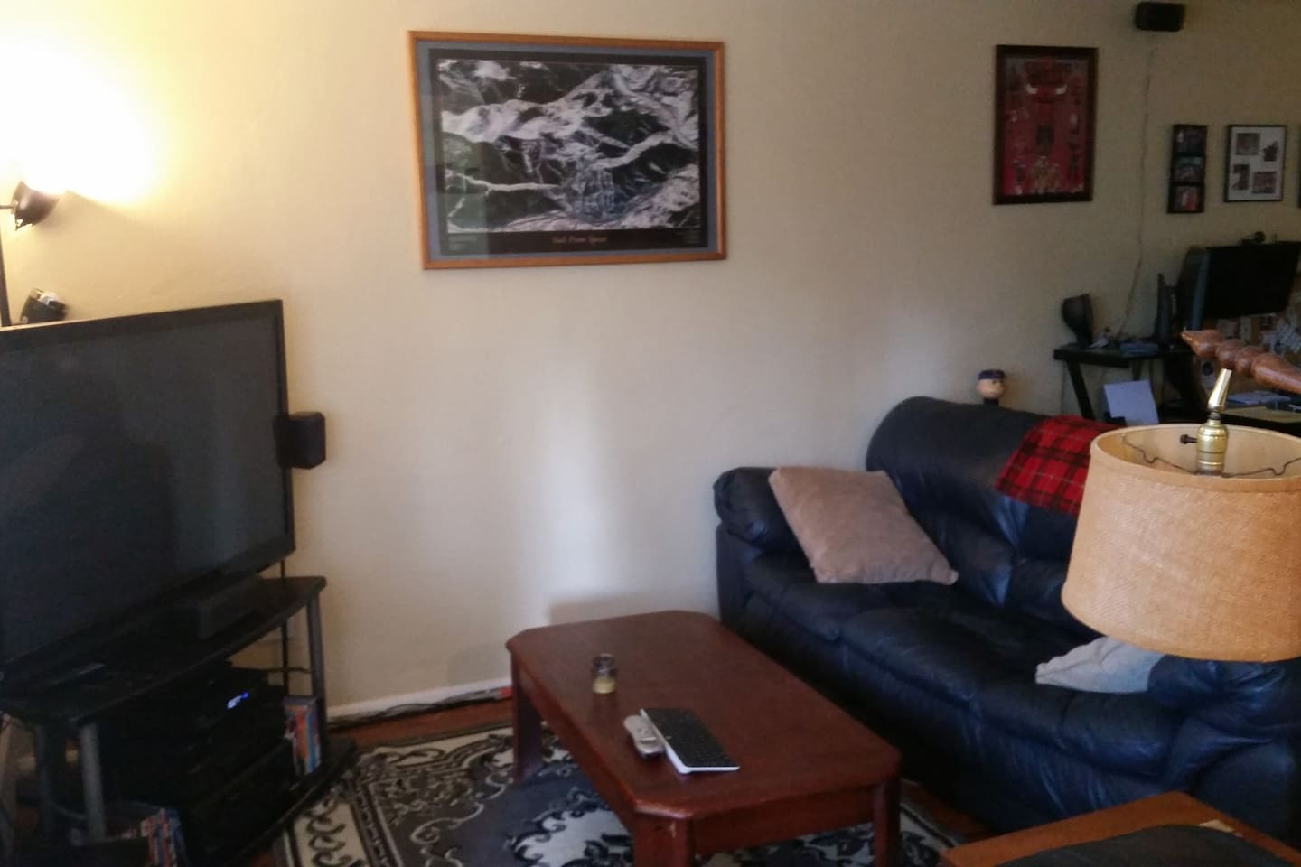 Living room with couch for a third person to sleep