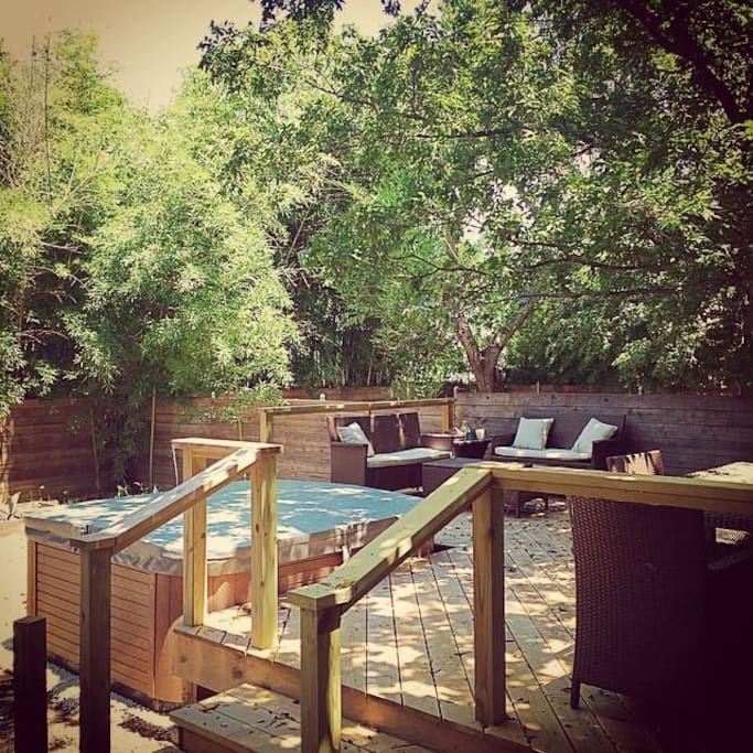 Backyard deck with hot tub.