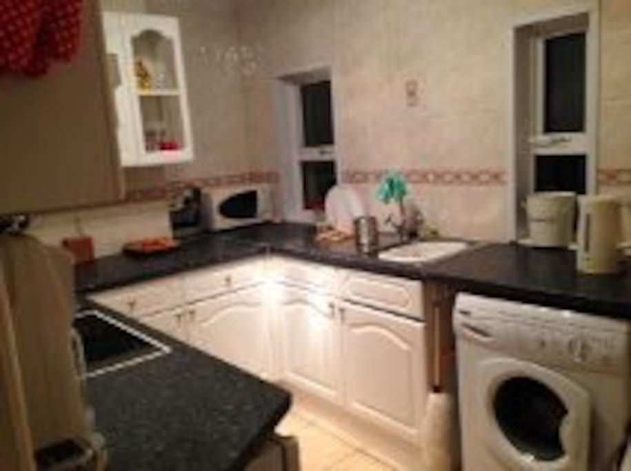 Cooking facilities (electric hobs; oven & microwave). Fridge. Washing machine.