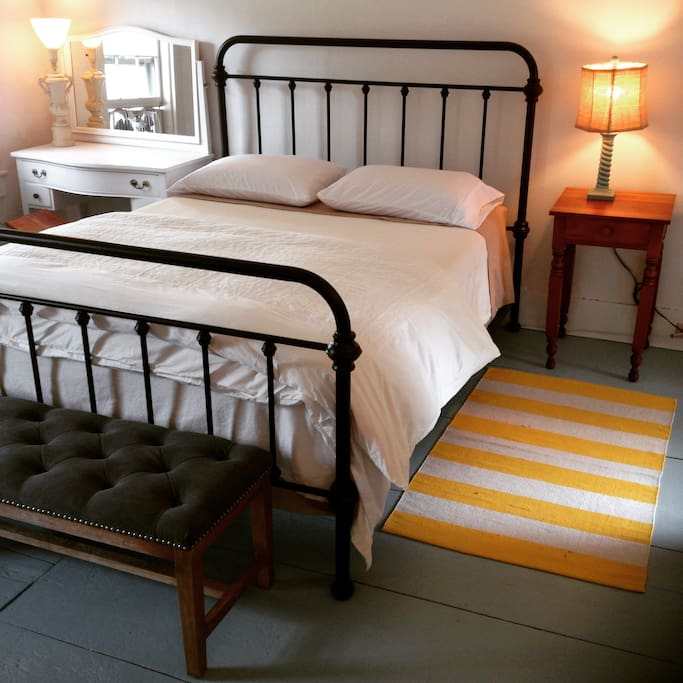Cozy and inviting.  Bench at the foot of the bed for a luggage perch, additional seating, whatever suits you.