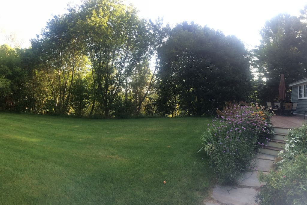 Private, flat back yard with trail leading to CT river