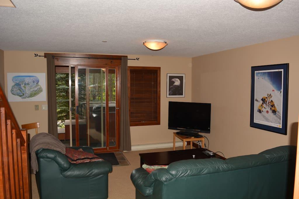 Lower Floor with sleeping area,TV room,patio door to hot tub.