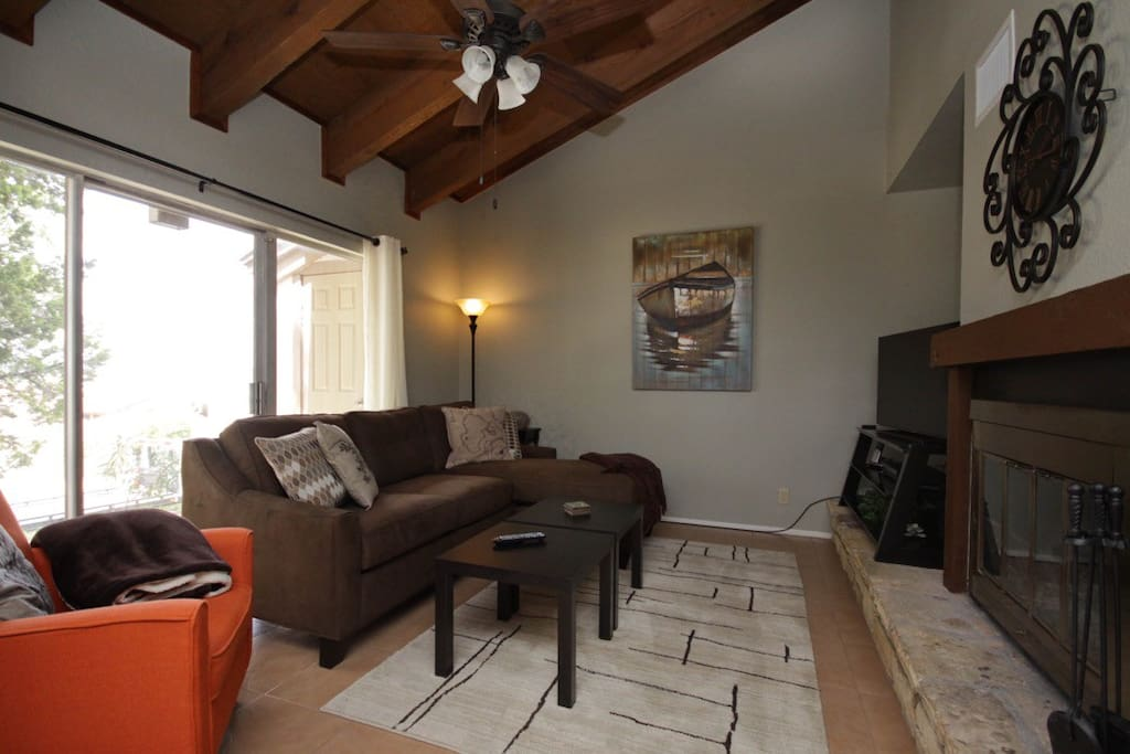 Family room has vaulted ceiling, ceiling fan, fireplace