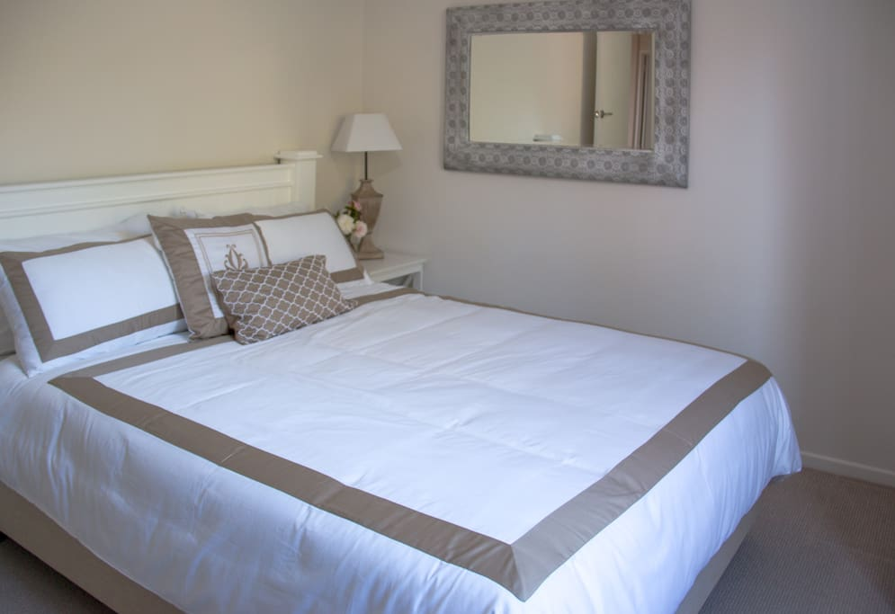 There are three comfortable rooms. Two with queen beds and one with two single beds.