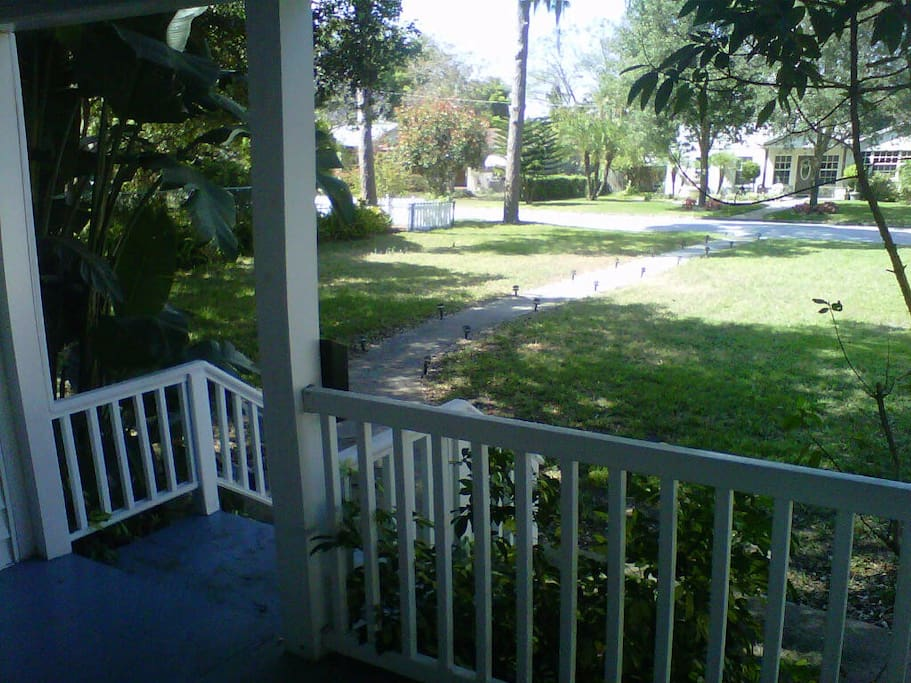 View of the garden and street from the front porch.