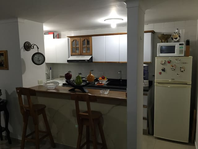 Kitchen with Microwave, Washer, Refrigerator, Oven and Everything you could possible need.