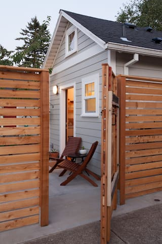 New slatted cedar gate is your private entrance to the tiny house patio.