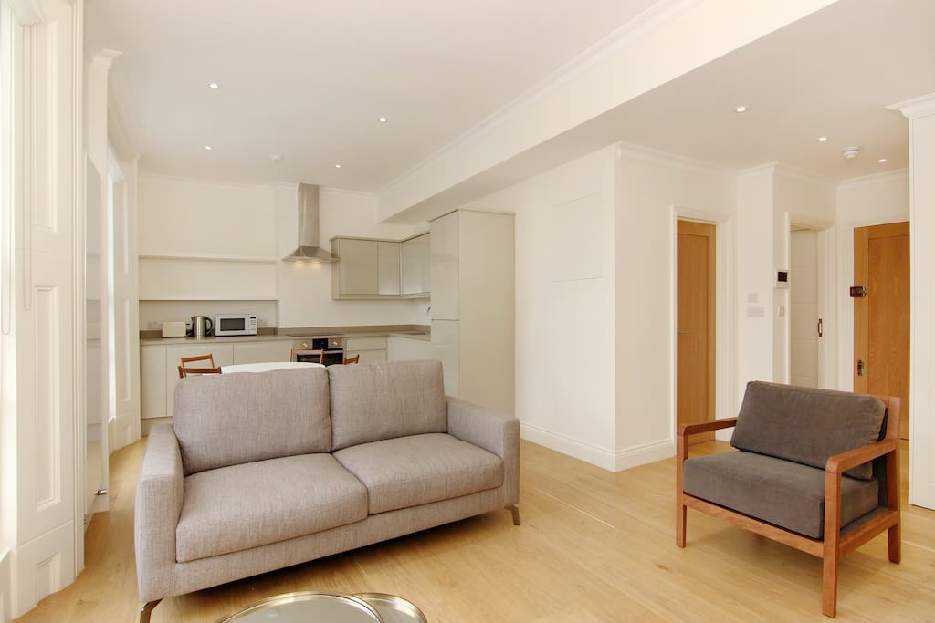 A superb open plan Lounge, dining area and kitchen with loads of daylight