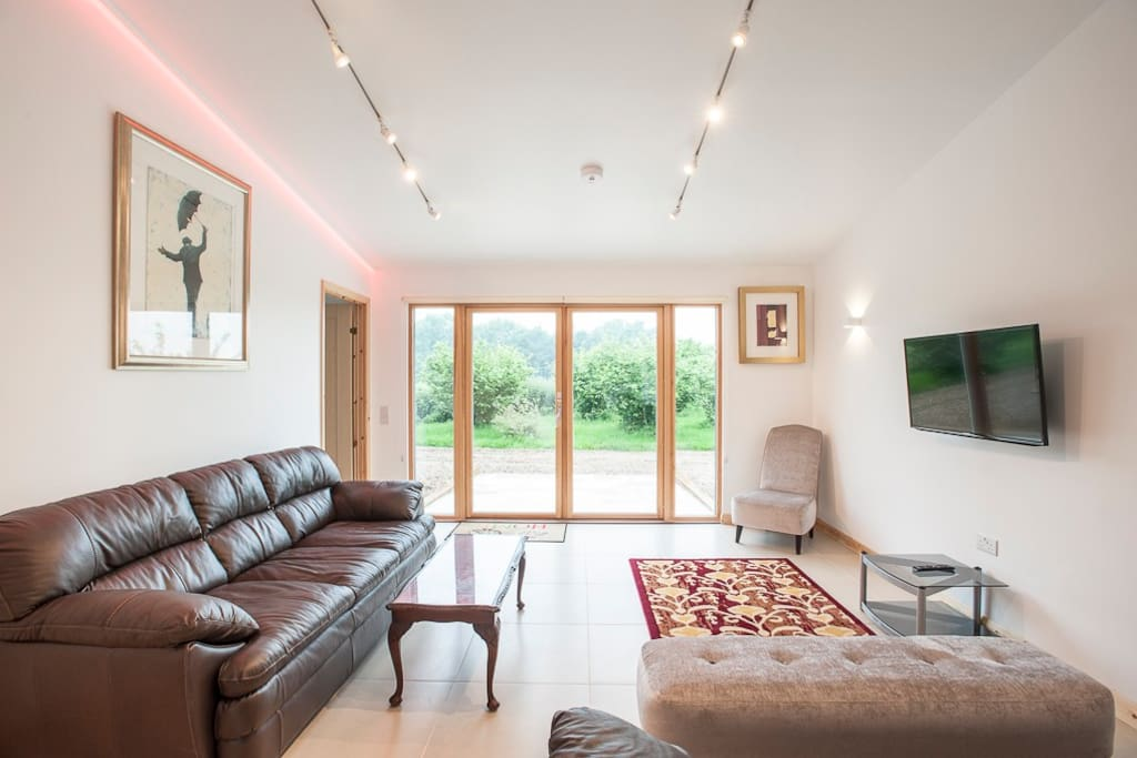 Open plan Sitting Room with optional colour changing LED lighting in every room