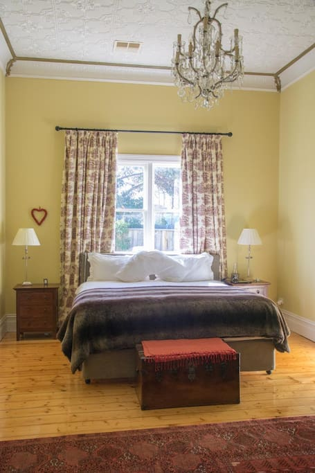 Master bedroom features 12-foot pressed metal ceilings, large walk-in wardrobe and ensuite