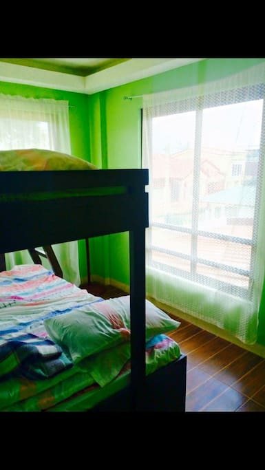 Green bedroom double deck with pull out bed for 4 pax