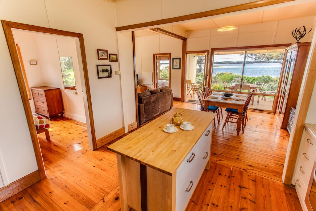 Open Plan living area overlooking Pelican Lagoon with fully equipped kitchen