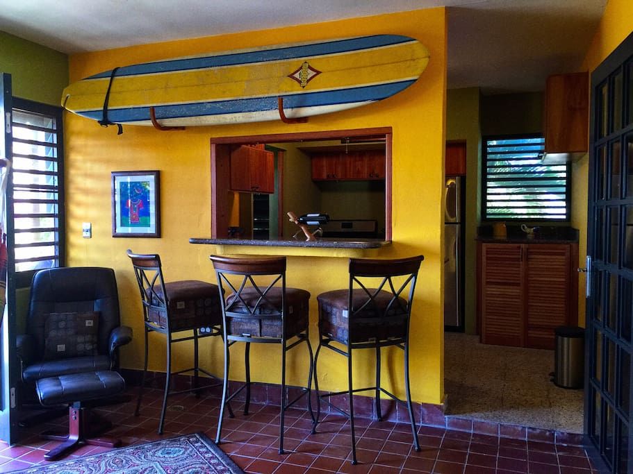 View to Kitchen from main living space (surfboard not for guest use).