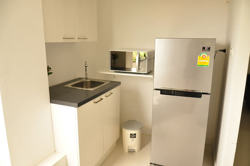 Small kitchen, in the cupboards you will find plates, glasses, fork & spoon etc.