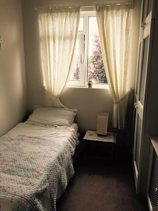 Single bed with natural lighting.