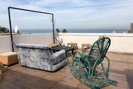 rooftop studio with sea view