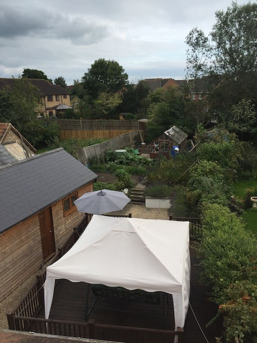 Rear large garden with large wooden deck with organic garden