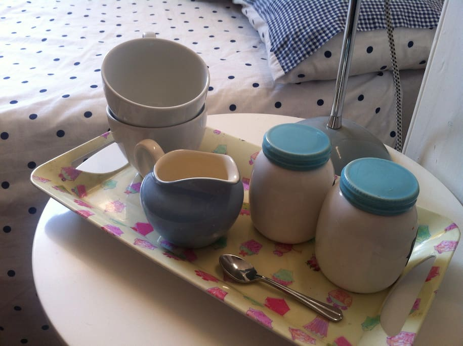 Breakfast tray with tea, coffee, milk and breakfast pastries, for you to enjoy breakfast in bed.