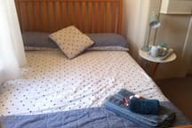 Comfortable double bed with fresh cotton bedding