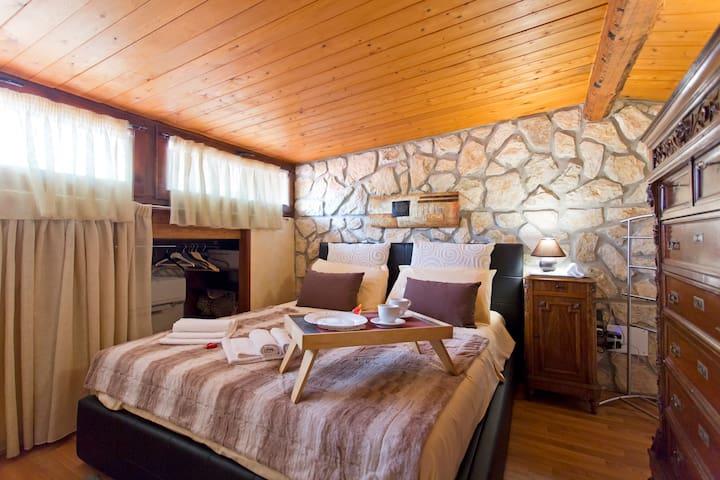 Calore, legno, pietra. La tua casa
