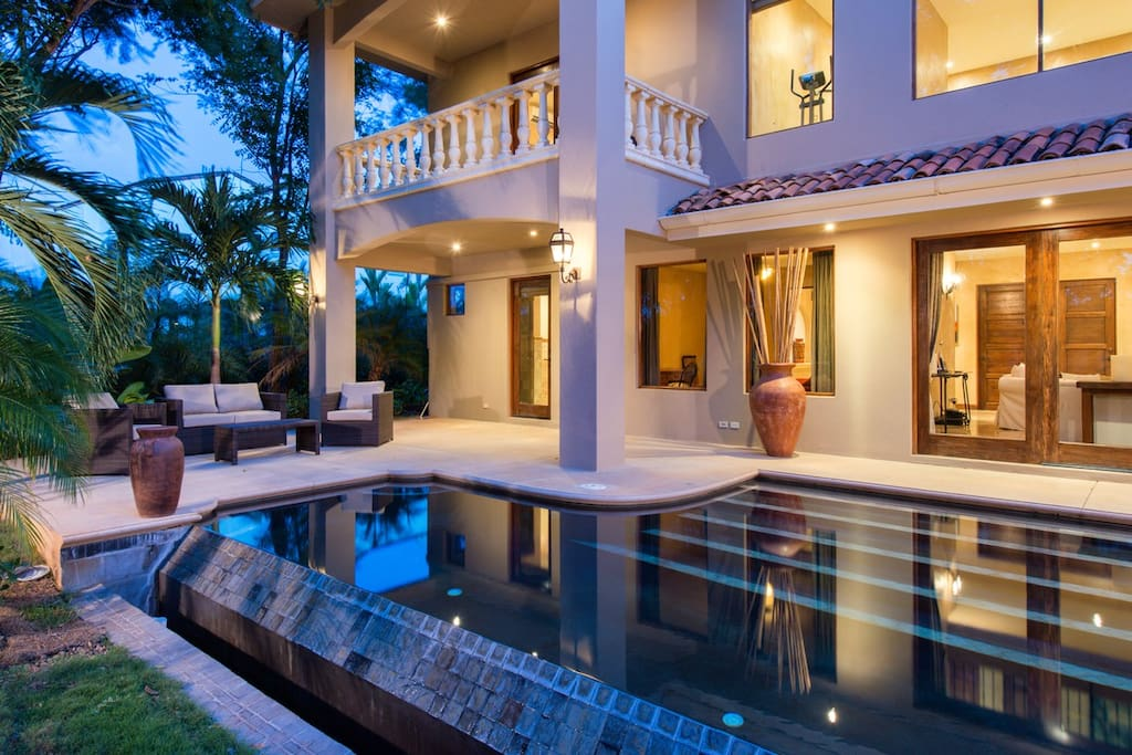 Pool with patio furniture