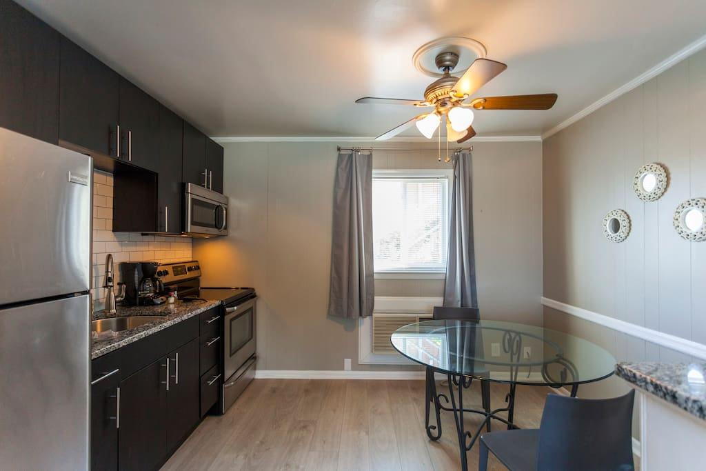 Stainless steal appliances (no dishwasher). A drip coffee maker, toaster, and basic kitchen supplies are provided.