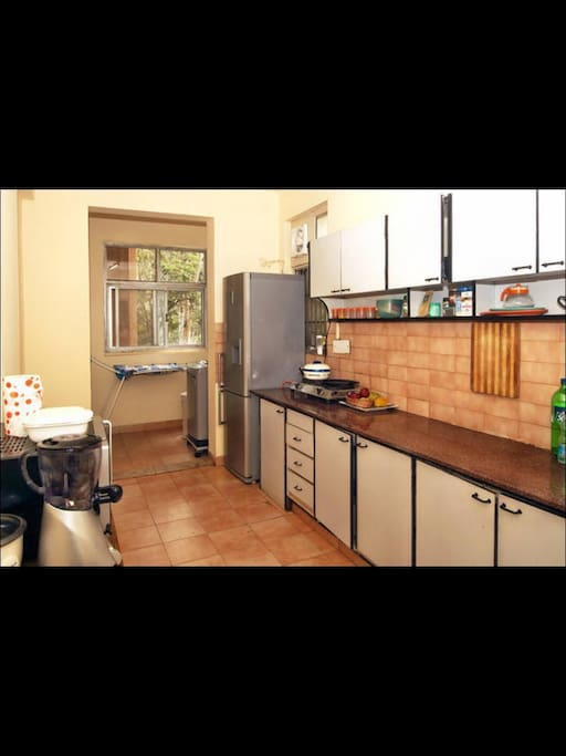 The laundry area and the kitchen