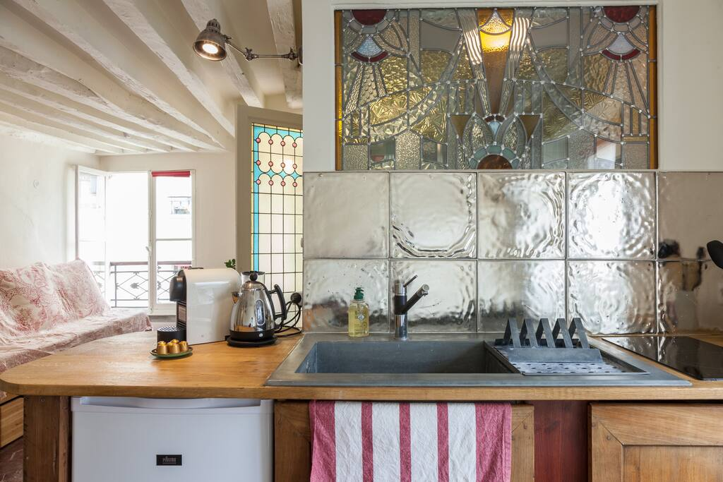 Open kitchen with  art deco stained glasses. Authentic materials: wood, zinc, handmade glasses and stained glasses.