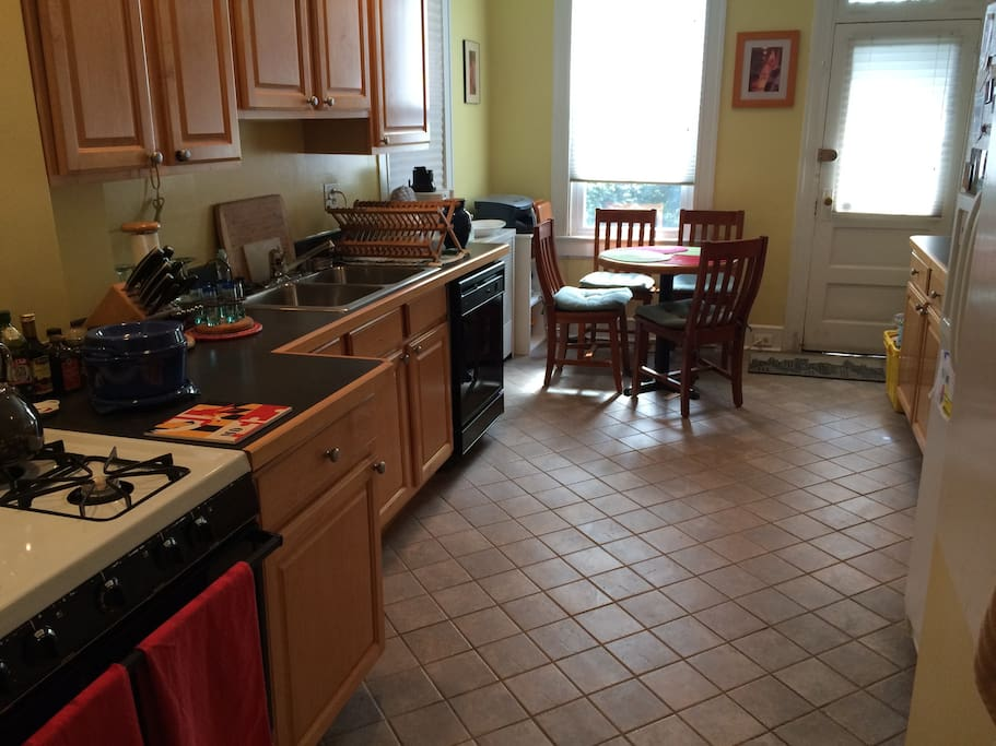 Large Kitchen with microwave, gas stove and ceiling fan