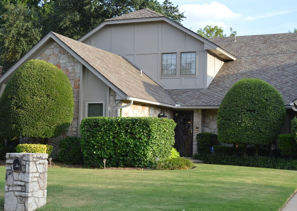 Two-story rock home in quiet suburban neighborhood on cul-de-sac with off-street parking.