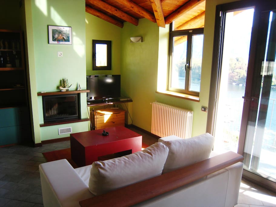 Lounge room with fireplace and satelite TV with sliding doors to the balcony overlooking Lake Como