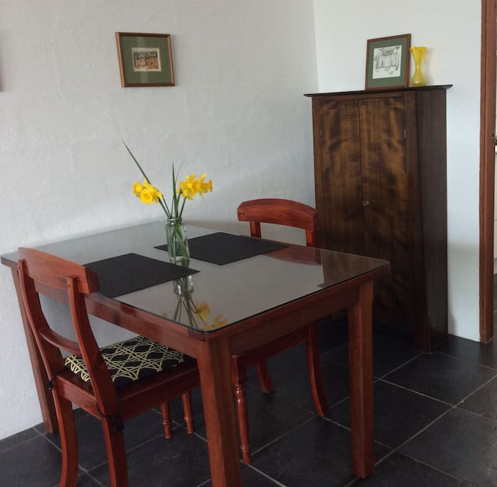 The dining table  near the entrance to the smart new kitchen